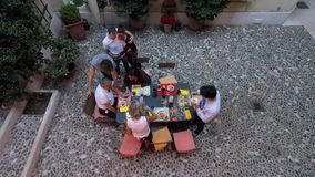 Timelapse Family Dinner in Trentino Italy. A dinner at home with family in Trentino, Italy in open air caputured from above with a timelapse recording. Trentino stock video footage