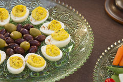 Before Dinner Horderves. Deviled eggs, kalamata and green olives served with carrots, jimaca and cherry tomatoes as a before dinner horderve Royalty Free Stock Photo