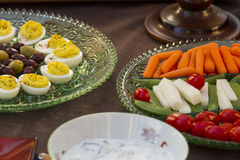 Before Dinner Horderves. Deviled eggs, kalamata and green olives served with carrots, jimaca and cherry tomatoes as a before dinner horderve Stock Photography
