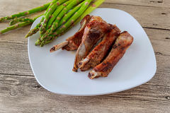 dinner of hot grilled beef meat ribs served with asparagus on plate Stock Photos