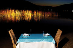 Dinner on lakeside. With blue tablecloth Royalty Free Stock Photos