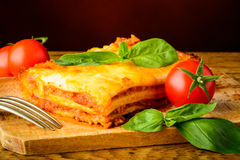 Dinner with lasagna bolognese Royalty Free Stock Photography