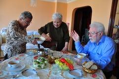 Dinner (lunch) time. A senior family having dinner (lunch Royalty Free Stock Photo