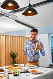 Dinner. Man Eating Pizza, Drinking Beer. Fast Food, Nutrition, L Stock Image