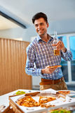 Dinner. Man Eating Pizza, Drinking Beer. Fast Food, Nutrition, L Royalty Free Stock Images