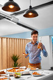 Dinner. Man Eating Pizza, Drinking Beer. Fast Food, Nutrition, L Royalty Free Stock Photo