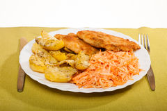 Dinner meal. Fried chicken roasted potatos and carrot salad. Royalty Free Stock Photography
