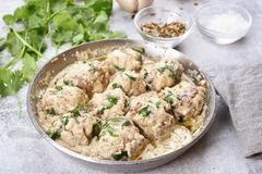 Dinner with meatballs in white sauce Royalty Free Stock Photos