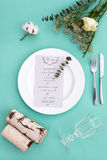 Dinner menu for a wedding or luxury evening meal. Table setting from above. Elegant empty plate, cutlery, glass and flowers Royalty Free Stock Image