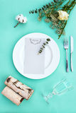 Dinner menu for a wedding or luxury evening meal. Table setting from above. Elegant empty plate, cutlery, glass and flowers Stock Photography