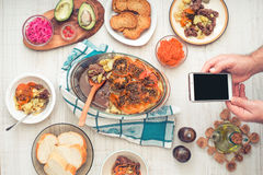 Dinner with mobile pgone horizontal Royalty Free Stock Images