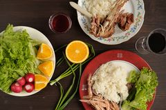 Dinner od turkey meat with rice, lettuce salad with radish, oran Stock Photos