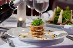 Dinner. Original dish of salmon with arugula and bread croutons Royalty Free Stock Photo