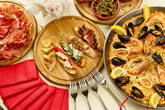 Dinner with paella. Spanish paella dinner prepared and is on the table Stock Photos
