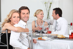 Dinner party. For two couples Royalty Free Stock Images