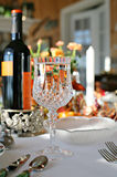 Dinner Party. A beautifully set dinner table with crystal wine glass royalty free stock photos