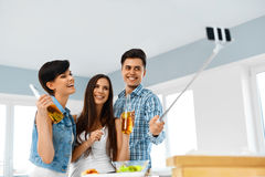 Dinner Party. Friends Having Fun, Taking Selfie. Holiday Celebra. Dinner Party At Home. Friends Having Fun, Taking Self-portrait Photo Using Smartphone Selfie Royalty Free Stock Images