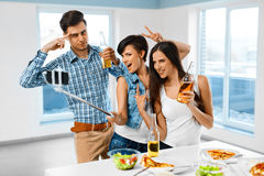 Dinner Party. Friends Having Fun, Taking Selfie. Holiday Celebra Stock Images