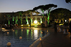 Dinner Party by the Pool - Night Scene - Fun Royalty Free Stock Photography