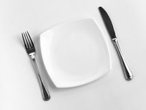 Dinner place for one person: plate, fork, knife Royalty Free Stock Photo