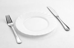 Dinner place for one person: plate, fork, knife Stock Images