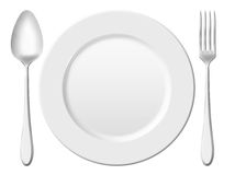 Dinner place setting. A white china plate with silver fork and spoon, isolated on white background Royalty Free Stock Photos