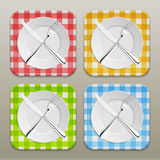 Dinner place setting icon set. Realistic white plate with silver fork and spoon on a checkered tablecloth background - Stock Image