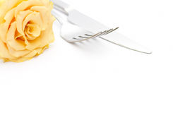 Dinner place setting. Knife and fork with yellow rose Royalty Free Stock Photo