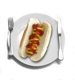 Dinner Place Setting at Table with Hotdog Royalty Free Stock Image