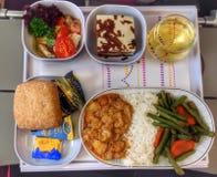 Dinner in plane Stock Photo