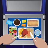 Dinner on the plane from first view. The man has dinner on the plane, first person view - airline meal concept Stock Image