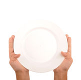 Dinner plate. Human hand showing a dinner plate Stock Photography