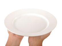 Dinner plate. Human hand showing a dinner plate Stock Images