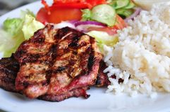 Steak dinner plate. Dinner plate of grill meat, rice and fresh vegetables Stock Photo