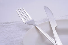 Dinner plate. Arrangement on white towel Royalty Free Stock Images