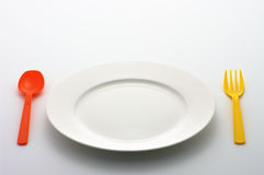 Dinner Plate, colorful Spoon and Fork Stock Photos