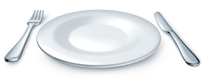 Dinner plate with fork and knife Royalty Free Stock Images