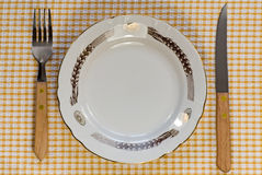 Dinner plate with fork and knife Stock Photos