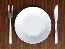 Dinner plate, fork and knife Stock Photos
