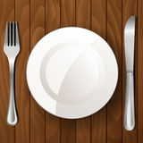 Dinner plate, knife and fork Stock Image