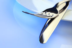 Dinner plate, knife and fork place setting Royalty Free Stock Photos