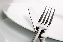 Dinner plate, knife and fork silverware Stock Photos