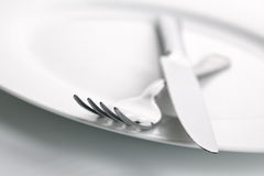 Dinner plate, knife and fork silverware Royalty Free Stock Photo