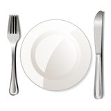 Dinner plate, knife and fork Stock Photo