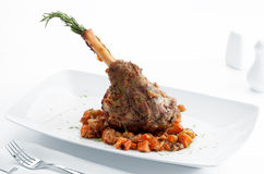 Dinner. Plate with roast leg of lamb, vegetables and rosemary on white back Royalty Free Stock Photo
