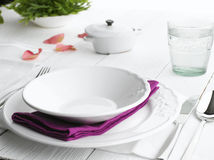 Dinner Plate Setting. Romantic place setting on white wooden table stock photography