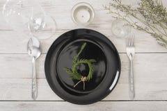Dinner plate setting on wood table. Dinner plate setting on wood table top view Stock Photo