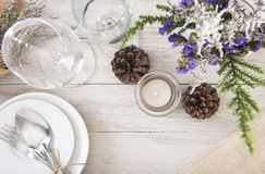 Dinner plate setting on wood table. Top view Royalty Free Stock Image