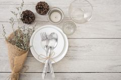 Dinner plate setting on wood table top view stock images