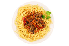 Dinner plate with spaghetti on white. Stock Image